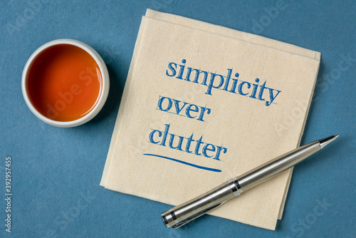 Fototapeta simplicity over clutter inspirational concept - writing on a napkin with a cup of tea, decluttering and minimalism obraz
