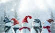 Leinwandbild Motiv Merry Christmas and happy New Year greeting card with copy-space.Many snowmen standing in winter Christmas landscape.Winter background