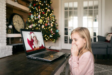 Girl Laughs When Santa Makes A Silly Face