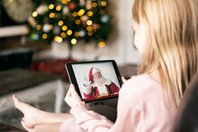 Young Girl Has Video Call With Santa Claus On Digital Tablet
