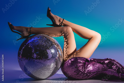 cropped view of elegant woman in sequin dress lying on floor with disco ball Canvas