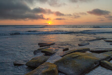 A Sunset From A Rocky Shore Al...