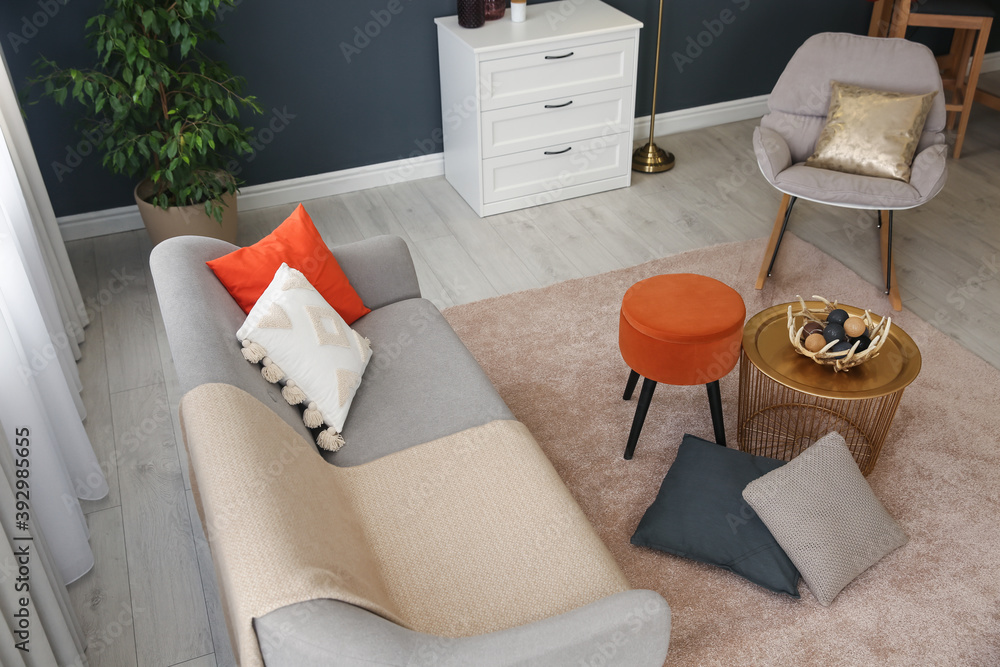 Fototapeta Cozy living room interior inspired by autumn colors, above view