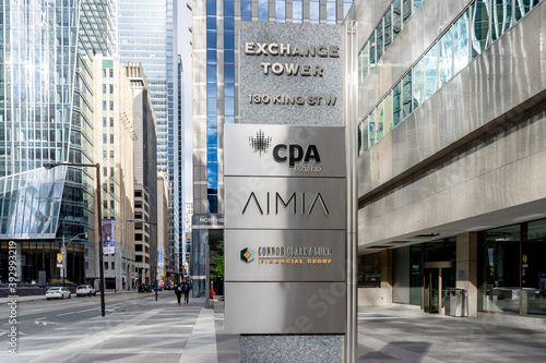 Fototapeta premium Toronto, Canada-October 24, 2020: CPA Ontario, AIMIA, Connor Clark & Lunn signs are seen on an exterior business directory sign outside Exchange Tower building in Toronto, Canada.