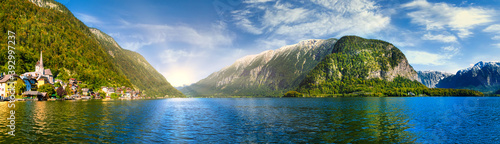 Fototapeta Scenic panoramic view of famous Hallstatt lakeside town reflecting in Hallstättersee lake in the Austrian Alps in scenic light on a beautiful sunny day in autumn, Salzkammergut region, Austria obraz
