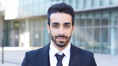 Smiling arabian businessman in the city. Canvas Print