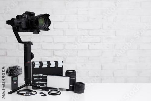Obraz na plátně videography concept - modern dslr camera on 3-axis gimbal stabilizer, lenses, mi