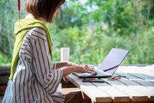 Woman Teleworking On An Outdoor Office As New Normal Work Style