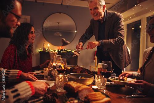 Family having Christmas dinner together Fototapet
