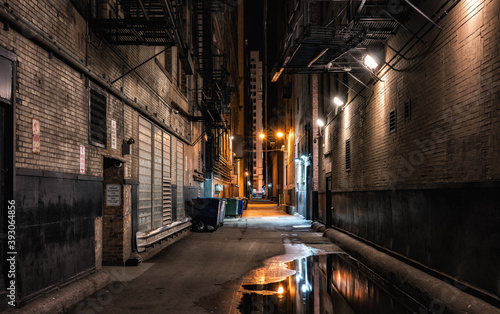 Dark abandoned alley at night downtown Chicago