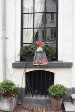 Lantern In Front Of A Window O...