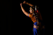 Kuchipudi Dancer Showing Her Back While Looking Sideways And Smiling