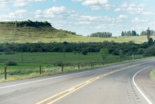 A Road That Turns To The Right Without Any Cars And Some Hills On The Background In Uruguay, Next To Tacuarembó