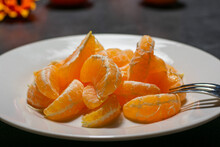Peeled Clementine On A A Plate
