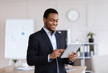 Happy African American Businessman Using Digital Tablet