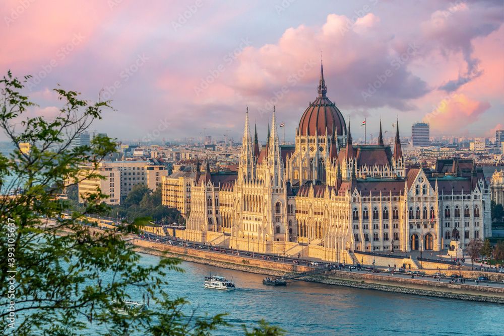 Fototapeta Aerial view of Budapest parliament andt the Danube river at sunset, Hungary