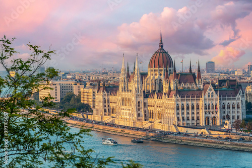 Aerial view of Budapest parliament andt the Danube river at sunset, Hungary #393105637
