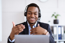 Happy Black Businessman With Headset Having Online Conference
