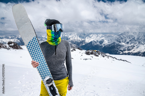Obraz na plátne An attractive slender woman skier stands without a jacket high in the mountains