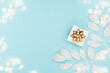 canvas print picture - Christmas card - Xmas gold gift box and silver decorations on pastel blue paper background.