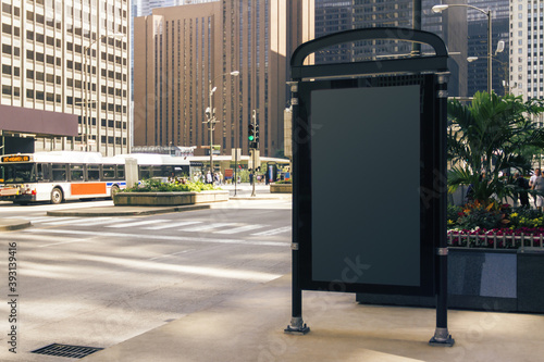 Blank black banner on the city street at daytime, mockup