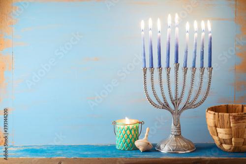 Fototapeta Jewish holiday Hanukkah concept with menorah on vintage background obraz