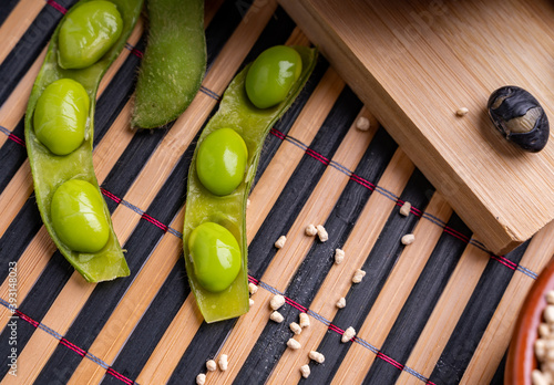 Obraz na plátne Soybean pods edamame soybeans with granulated soy lecithin and black and white s