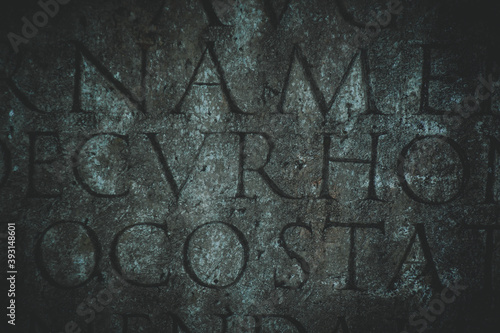 Fototapeta Ancient Roman text carved in stone, background or book cover