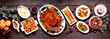 canvas print picture Traditional Christmas turkey dinner. Top view panoramic table scene on a dark wood banner background. Turkey, potatoes and sides, dressing, fruit cake and plum pudding.