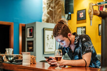 Male Bartender Leaning On Wood...