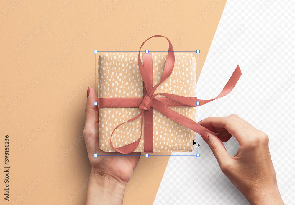 Fototapeta Mockup of Hands Holding Gift Box with Ribbon