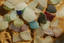Close Up Of Variety Of Colorful Stones On Sand