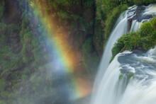 High Angle View Of Iguazu Falls With Rainbow