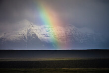 Scenic View Of Rainbow Over Mountains In Iceland