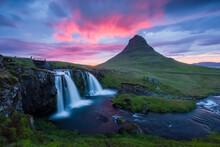 Scenic View Of Kirkjufellsfoss Waterfall During Sunset