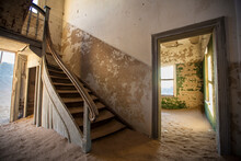Interior View Of Abandoned Sand Filled House Of Ghost Town