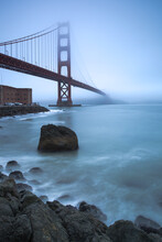 Scenic View Of Golden Gate Bridge Covered With Fog In Early Morning Light