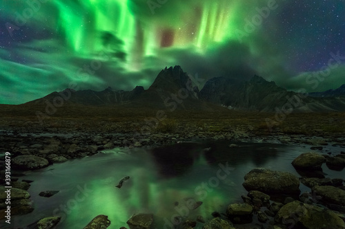 Scenic view of Aurora Borealis over Ogilvie Mountains Wallpaper Mural