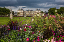 Scenic View Of Luxembourg Palace Against Cloudy Sky In Luxembourg Gardens