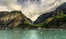 Scenic View Of Tracy Arm Fjord And Mountain Against Cloudy Sky