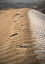 Close Up Of Footprints On Sand...