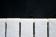 Snow Covered Edge Of A Pier An...