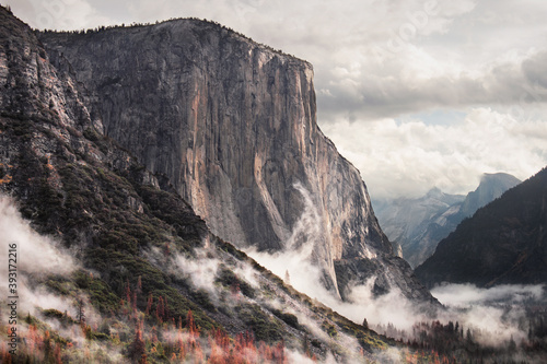 A storm breaks surrounding El Capitan with clouds in California's Yosemite National Park