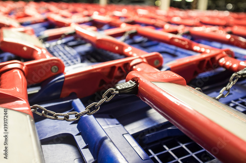 Blue-red shopping carts on a parking