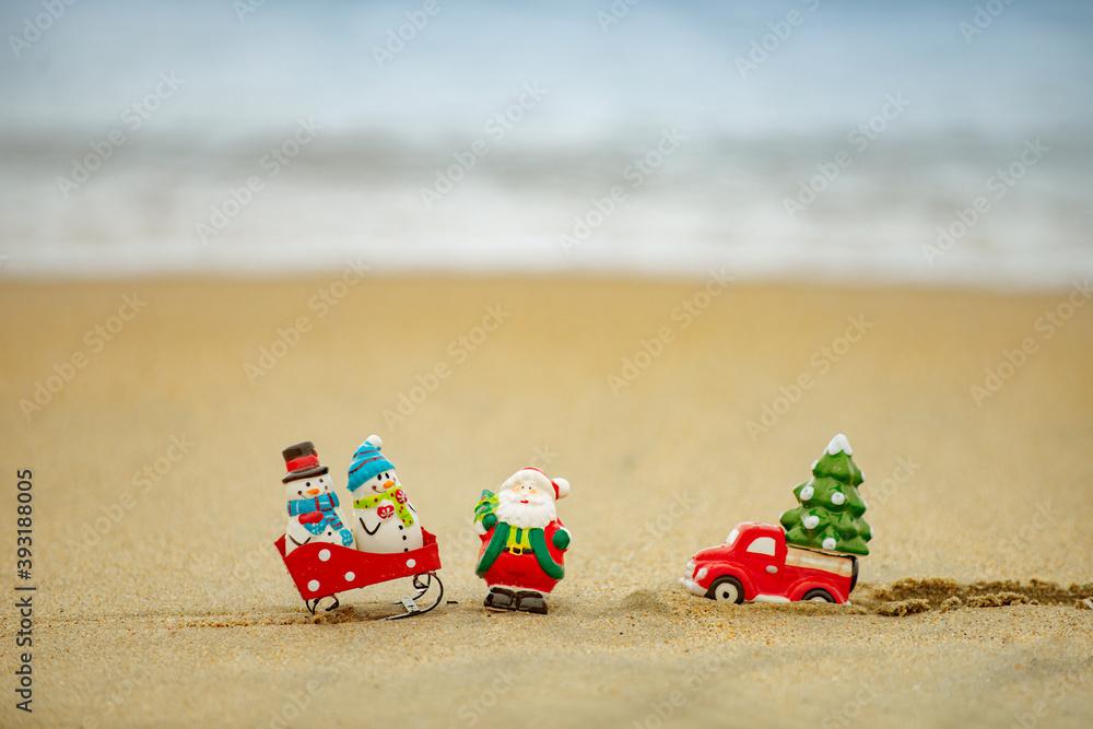Fototapeta Christmas on summer sea background. Tropical paradise, ocean beach texture for new year banner.