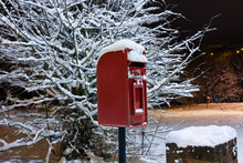 Traditional Red Postbox In The Snow