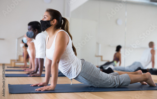 Concentrated young hispanic woman in protective mask to prevent respiratory infe Fototapete