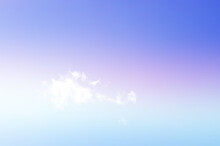 Beautiful Blue And Pinkish Sky With Faint And Scattered Clouds
