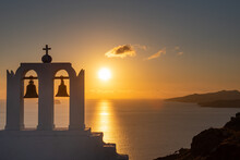 Sunset View Across Santorini Caldera. Chapel In The Foreground.