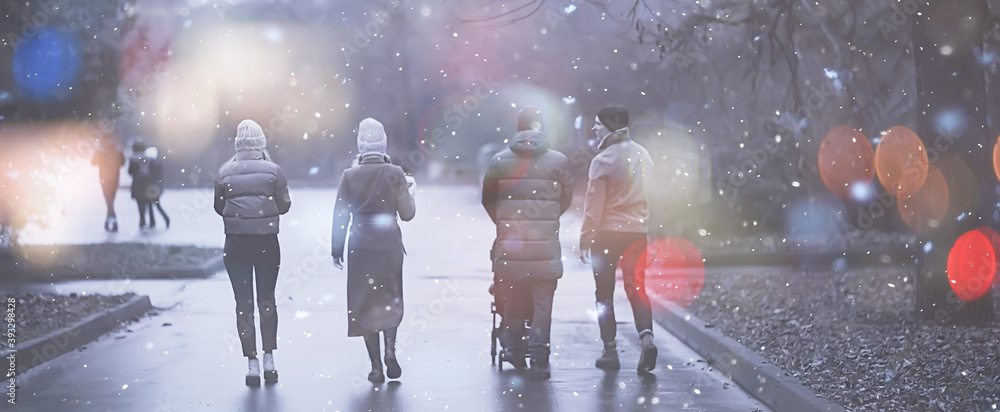 Fototapeta winter walk in the park, young family with a small child and friends, young parents outside seasonal look